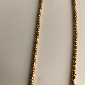 Gold tone rope necklace